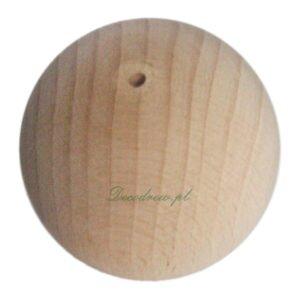 Duża drewniana kulka z otworem.
