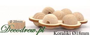 Małe drewniane koraliki dla dzieci, umieszczone w podstawce kwaitaku.