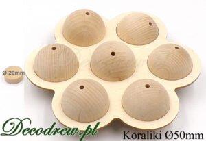 Duże XXL drewniane korale do wyrobu biżuterii, surowe średnicy 50mm. Zaprezentowane w formie ozdobnego kwiatu z kulek.
