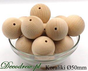 Duże 50mm korale drewniane producent elementów toczonych, tokarstwo w drewnie. Kulki drewniane prezentowane w misie szklanej.